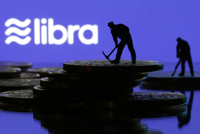 Small toy figures are seen on representations of virtual currency in front of the Libra logo in this illustration picture, June 21, 2019. REUTERS/Dado Ruvic/Illustration - RC11B30C87B0