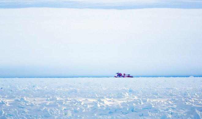 This image taken by Andrew Peacock of www.footloosefotography.com on December 28, 2013 shows the Chinese icebreaker Xue Long getting as close as thick pack ice would allow before it could not go any further, in an aborted effort to reach the ship MV Akade